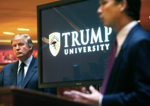 """FILE- In this May 23, 2005 file photo, then real estate mogul and Reality TV star Donald Trump, left, listens as Michael Sexton introduces him at a news conference in New York where he announced the establishment of Trump University. A federal judge in San Diego will consider arguments on President-elect Trump's latest request to delay a civil fraud trial involving his now-defunct Trump University until after his inauguration on Jan. 20, 2017. Trump's attorneys said in a court filing ahead of the hearing, Friday, Nov. 18, 2016, that preparations for the White House were """"critical and all-consuming."""" (AP Photo/Bebeto Matthews, File)"""