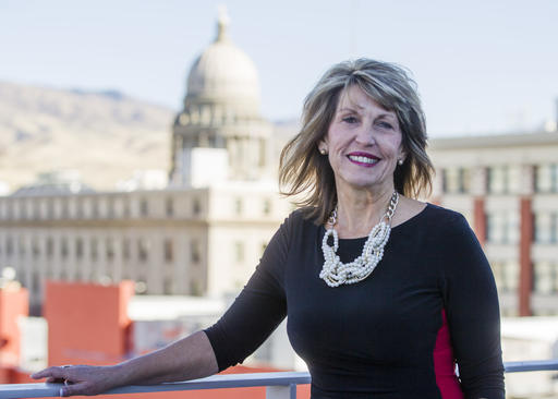 """Melinda Smyser, one of Idaho's four presidential electors, poses for a portrait in Boise, Idaho, Thursday, Nov. 17, 2016. Grassroots campaigns around the country are trying to persuade members of the Electoral College to vote against Donald Trump and deny him the 270 votes he needs to assume the presidency. Smyser, one of Idaho's four Republican electors, said they have been flooded with emails, telephone calls and Facebook messages from strangers urging them to reconsider their vote. """"It's just not going to work,"""" Bangerter (AP Photo/Otto Kitsinger)"""