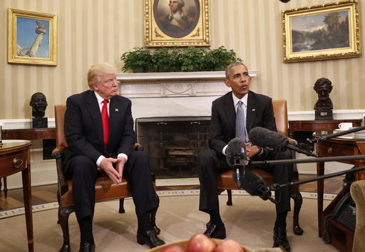 FILE - In this Nov. 10, 2016 file photo, President Barack Obama meets with President-elect Donald Trump in the Oval Office of the White House in Washington. President Barack Obama took on America's problems of a lack of access to health care and high cost, but he and the Democrats paid a political price. Now President-elect Donald Trump has promised to undo much of what Obama put in place while vowing to make the system better for average folks.  (AP Photo/Pablo Martinez Monsivais, File)
