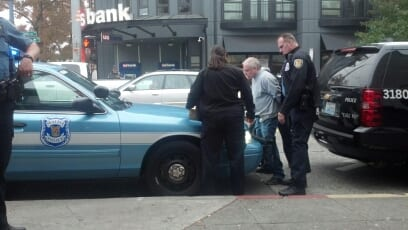 A man suspected of robbing a Broadway Chase bank is taken into custody less than 30 minutes after the incident Wednesday morning (Image: Jacob Olson for CHS)