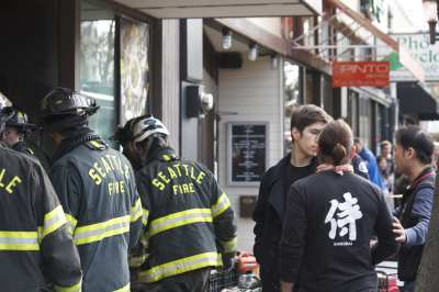 Samurai Noodle staff watch during the nearly 30-minute Seattle Fire response (Image: CHS)