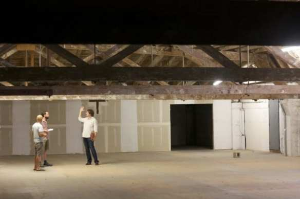 Jerry Everard inside the old Seneca warehouse being built into a new entertainment development on the backside of Pike/Pine (Image: CHS)