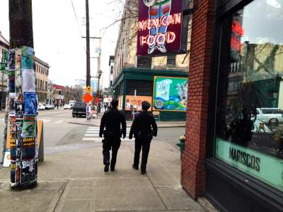Two East Precinct officers on patrol -- on foot -- on E Pike (Image: CHS)