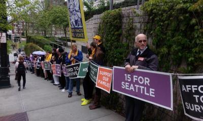 Demonstrators surrounded City Hall Wednesday (Image: Working Washington)