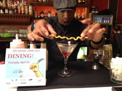 """A bartender at 12th Ave's Manhattan prepares """"a signature Dining Out For Life cocktail"""" (Image: Lifelong)"""