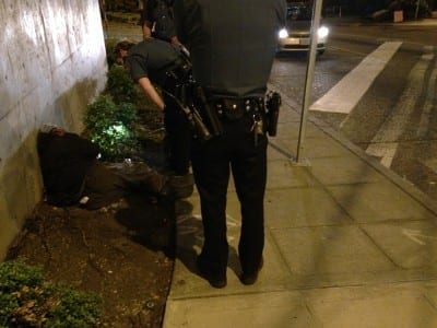 """SPD assists a man who had fallen and passed out along Broadway during a CHS """"ride along"""" with an East Precinct officer Saturday night, May 24. CHS will use the experience to -- hopefully -- bring you even more accurate coverage of policing in the neighborhood"""