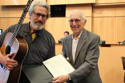 """""""Councilmember Licata presents Jim Page Proclamation recognizing 40th anniversary of street musician ordinance and 2014's Busker week"""" (Image: City of Seattle via Flickr)"""