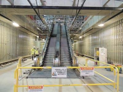 Escalators leading up to mezzanine level of the UW light rail station (Image: CHS)