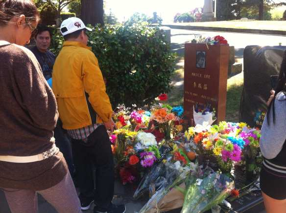 Visitors to the Lee grave on the 40th anniversary of the martial arts legend's death in summer 2013 (Image: CHS)