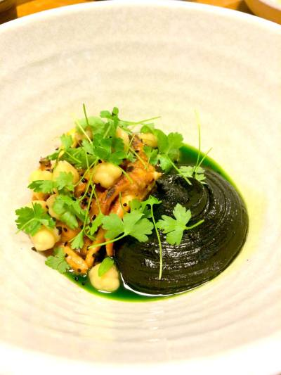 """To celebrate its second anniversary, Mamnoon is bringing back classics like Habbar: """"marinated & grilled octopus, aleppo chili, chickpeas, cumin, inked hummus, nigella, and parsley"""" (Image: Mamnoon)"""