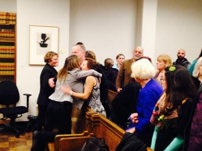 Yancy Noll's family and friends embrace after the hearing (Photo: CHS)