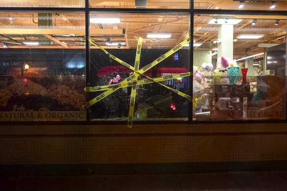 Both Broadway QFCs shut down early -- the Broadway Market store suffered some broken glass (Image: Tim Durkan)