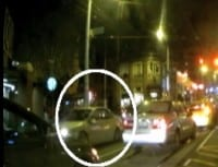 A still from the video appears to have captured images of the assailant's vehicle heading south on Broadway (Image via KIRO video clip)