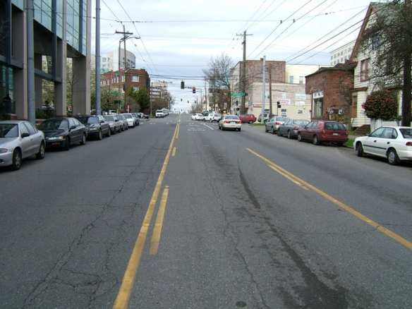 A scene of Broadway with suicide lane, no streetcar tracks, no bikeway. (Photo by Rob Ketcherside)