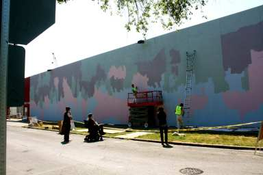Artist Baso Fibonacci assesses his canvas before work starts on what would become an iconic image in the neighborhood (Image: CHS)