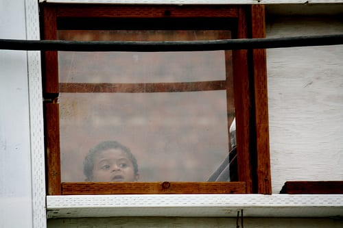 A child watches work at the station site through one of the construction wall's viewing windows (Image: CHS)