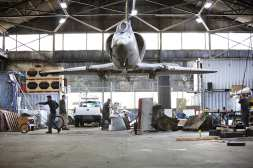 Capitol Hill Station will be art-filled including a sculpture made from a reinvented fighter jet. Here, Mike Ross and crew in 2010 after after receiving the A4 fighter jet for the future installation in Capitol Hill Station (Image: Kat Nyberg Photography with permission to CHS)