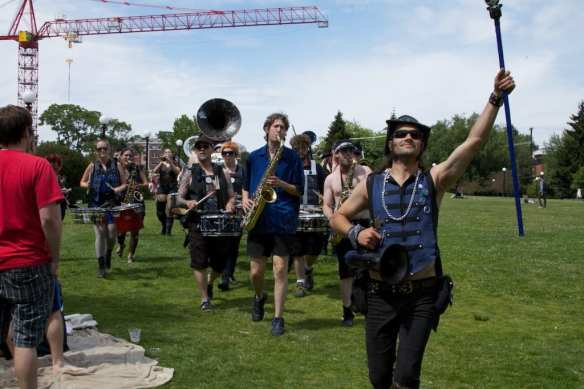 Brass musicians march at a past HONK! Fest 4th of July show (Images: Mike Antares)