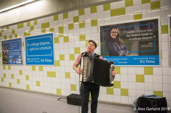 A busker at Capitol Hill Station's grand opening earlier this year