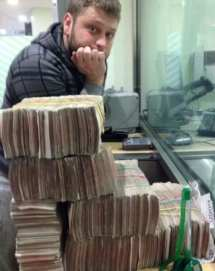 Seleznev in happier times with stacks of cash (Image: Department of Justice)