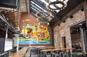 """""""A focal point inside the brewpub is a custom mural by Grammy-nominated Seattle illustrator and Sub Pop Records Art Director Sasha Barr. The prominent mural on the wall near the front bar is a colorful collage celebrating the city, people, beer, architecture, and the neighborhood."""" (Images: R