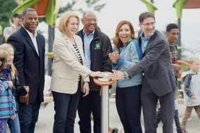 From left to right: Christopher Williams, Jenny Durkan, Andrew Lofton, Teresa Mosqueda and Adrian Hanauer together pressing a button that would activate the park's fountain for the first time ever.