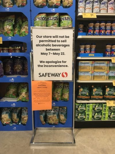 A sign tells part of the story at the 15th and John Safeway