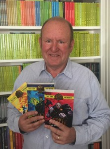 Ian Livingstone with the first Fighting Fantasy releases from Scholastic UK