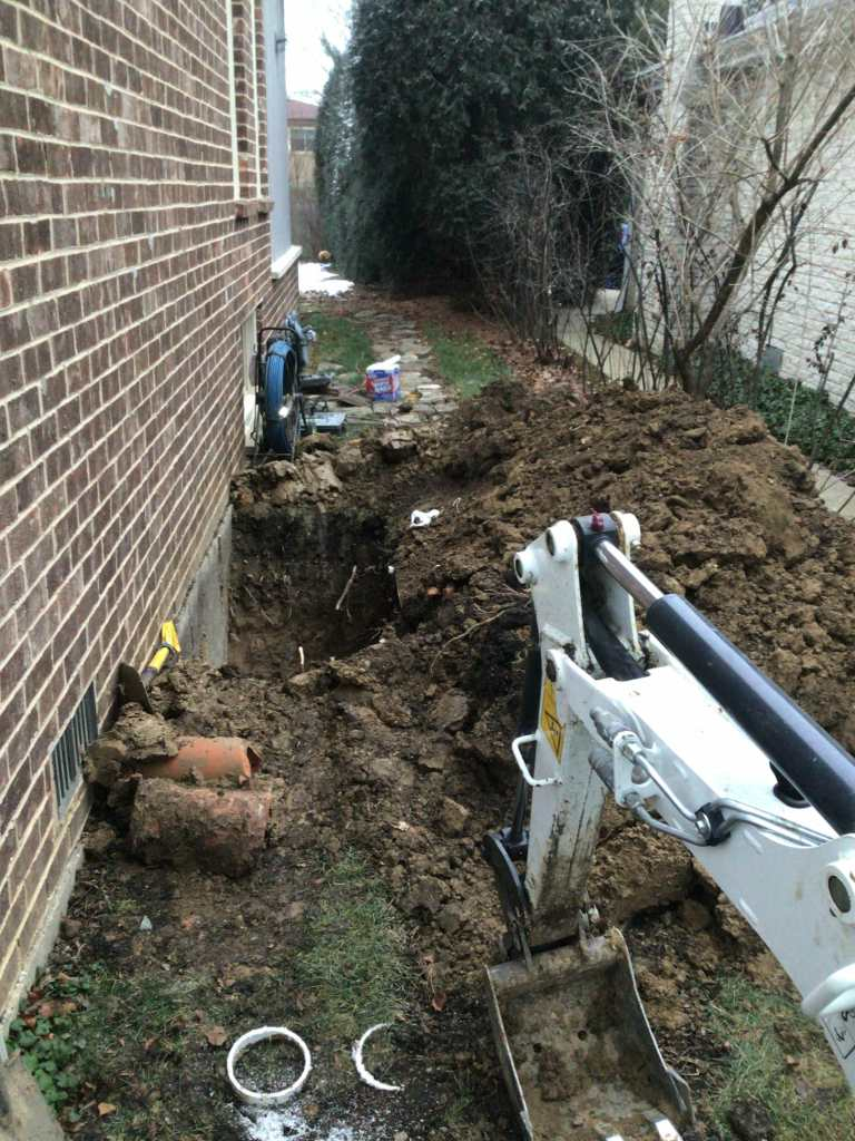 Digging to Reach Sewer Line