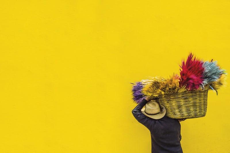 guatemalan man carrying basket