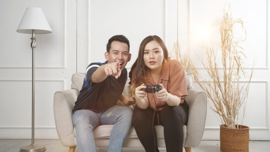 couple playing console fun game
