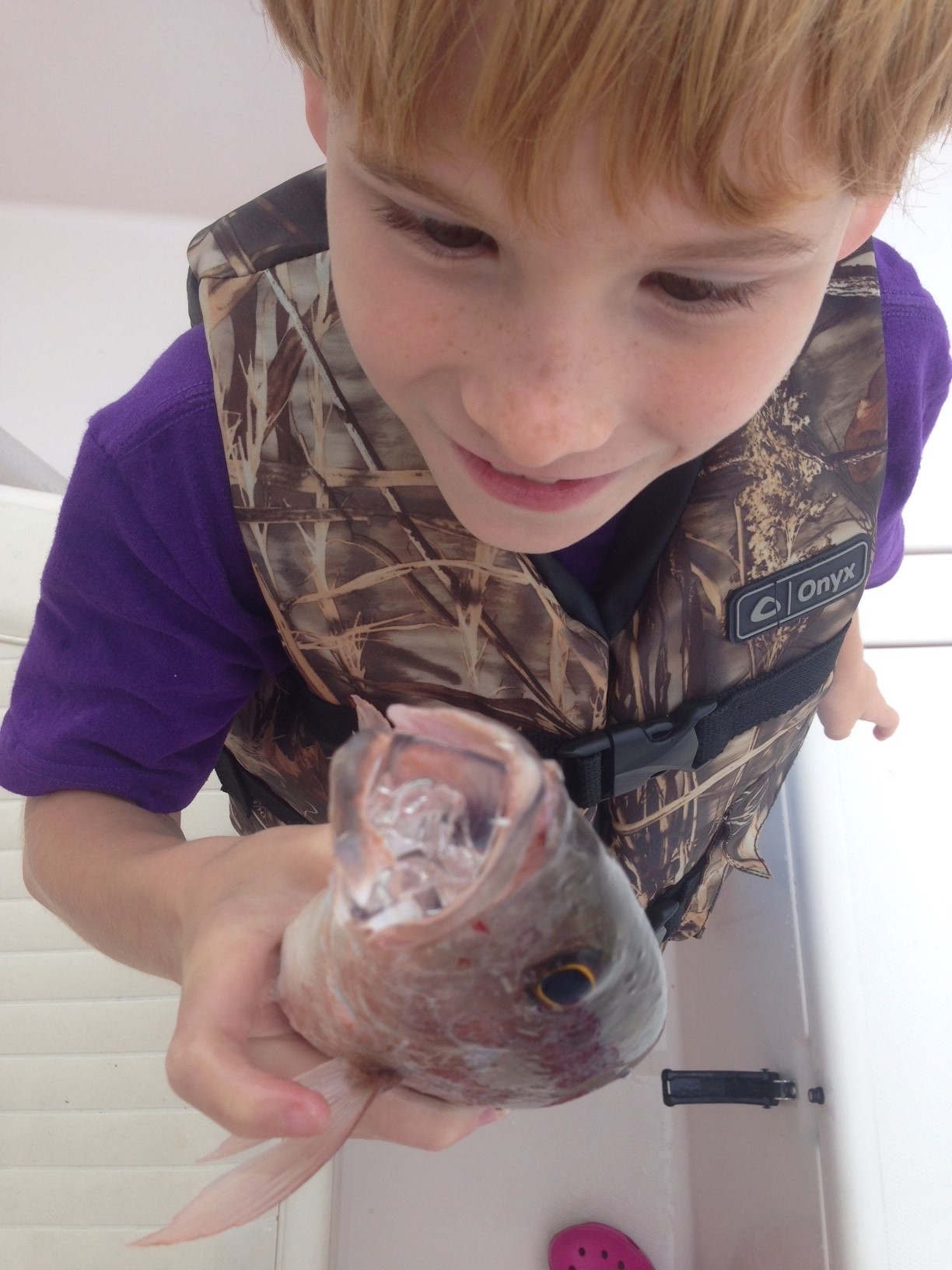 Aidan is admiring his mangrove snapper.