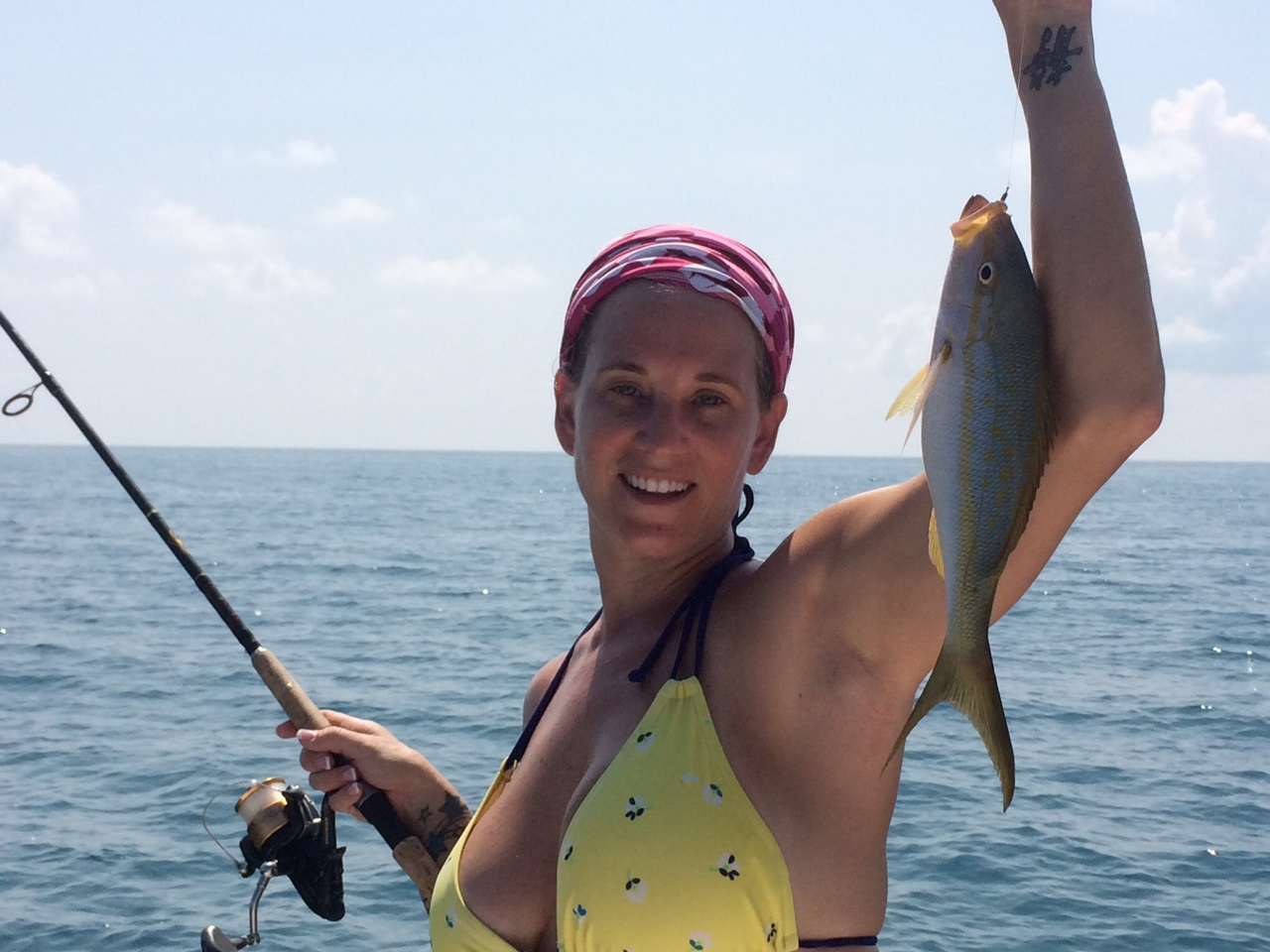 Melissa holding her yellowtail snapper caught off Marathon in the Fl Keys.