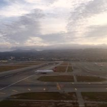 A takeoff side view looking down SFO 01L as Virgin crosses and the clouds stream by! (riding in the back)