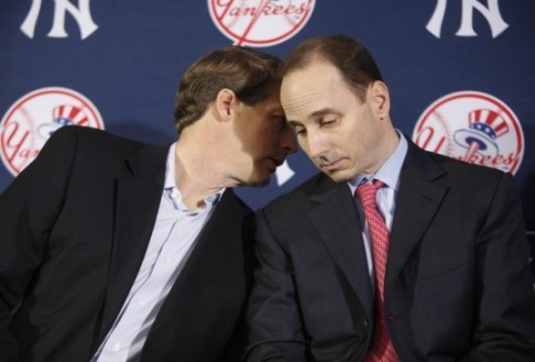 Hal Steinbrenner and Brian Cashman have enjoyed a good relationship, but will it become strained by the team's budget? (Photo: Getty Images)
