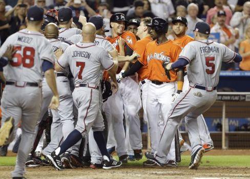 The Atlanta Braves gather around  the smiling Jose Fernandez. (Photo: AP)