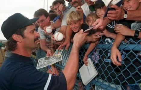 Don Mattingly signs for autograph seekers at Ft. Lauderdale Stadium.