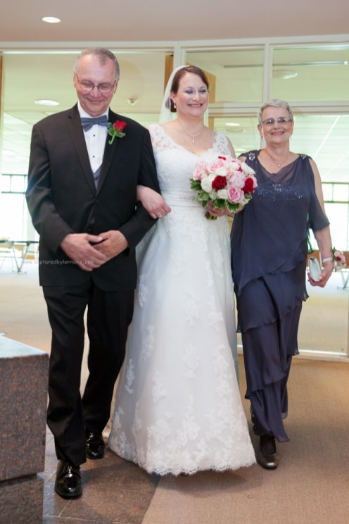 Bride family walk down aisle