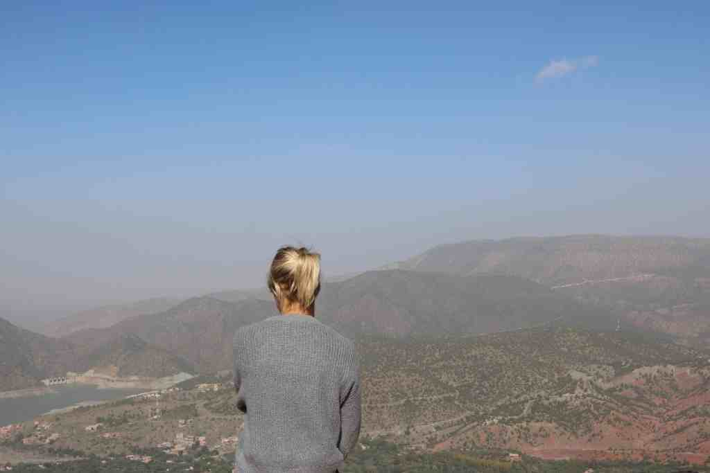 Girl with blonde ponytail overlooking a Mountain View