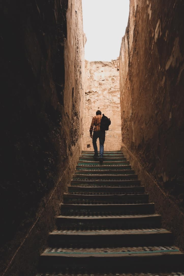 Guy with backpack going up stairs in Marrakech