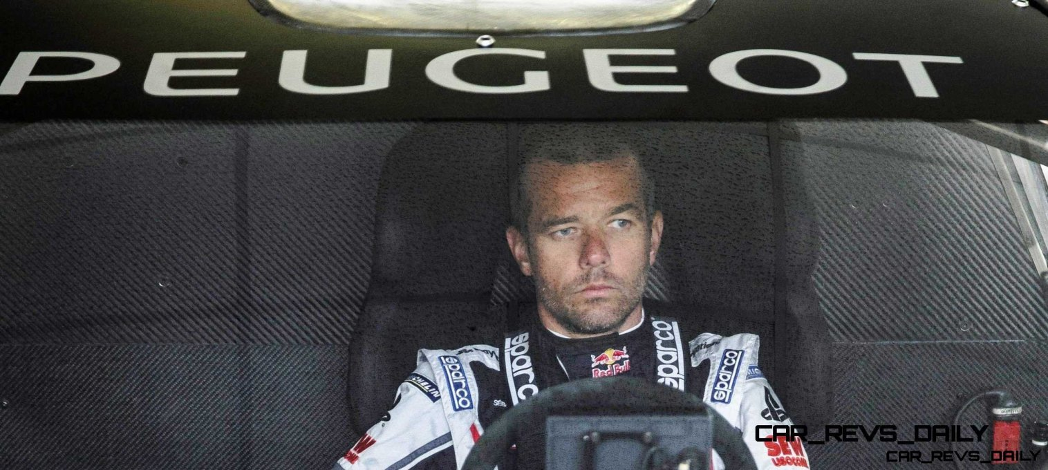 Sebastien Loeb wait while the engineers and mechanics adjust the 208T16 for the first test track at the Peugeot test center in La Ferté-Vidame, France, on April 18th, 2013