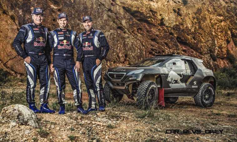 Carlos Sainz, Cyril Despres and Stephane Peterhansel pose for a
