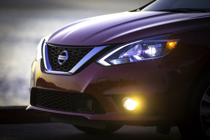 The new 2016 Nissan Sentra exterior redesign brings its appearance closer in look and feel to its more upscale showroom siblings. All three Nissan sedans – Maxima, Altima and now Sentra – reflect Nissan's new design language first introduced on the dramatic Nissan Murano crossover. Key features of the 2016 Sentra exterior include a new front fascia, grille, fenders, hood and signature boomerang-shaped headlights. New LED low-beam headlights with LED signature accents are offered on Sentra SR and Sentra SL grades. In the rear, a new fascia with redesigned boomerang-shaped taillights adds a more premium appearance. There are also two new 17-inch wheel designs for SR and SL grades, as well as a new SV 16-inch aluminum-alloy wheel design.