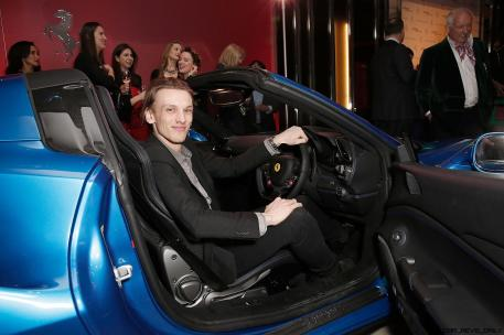 Jamie Campbell Bower inside the Ferrari 488 Spider at the UK launch at the Watches of Switzerland store London