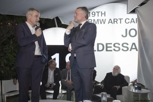 Jens Marquardt and Dr. Thomas Girst celebrated the world premiere of the 19th BMW Art Car, created by renowned American artist John Baldessari, at Art Basel in Miami Beach on Wednesday, November 30, 2016.