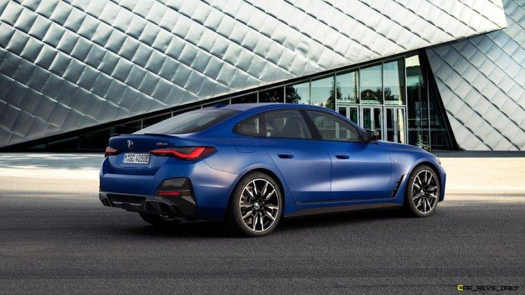 2022-BMW-i4-M50-rear-static-fancy-silver-building