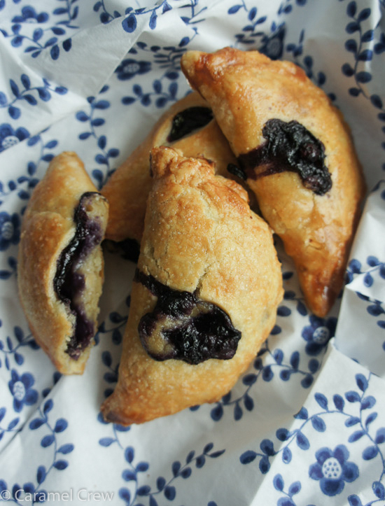 Homemade blueberry hand pies that are filled with blueberries and a dreamy ginger vanilla custard inside a buttery crust- a pretty and delicious blueberry dessert.