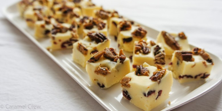 Easy, irresistible white chocolate fudge recipe - just the right amount of crunch from caramelized pecans and a sweet berry flavor from dried cranberries.