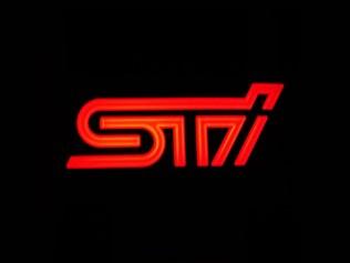 Logo retroluminiscente STI