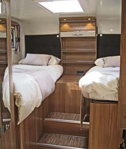 The Autograph 750 has two fixed single beds over the garage